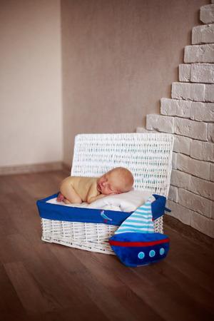 sleeper: sleeper newborn baby in white box Stock Photo