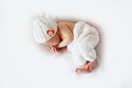 sleeper newborn baby on a gray background Stock Photo