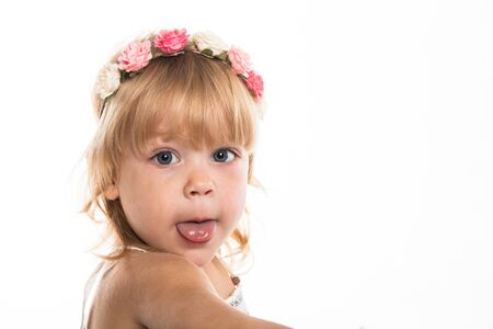 silliness: Girl with a wreath of flowers on her head on a white background