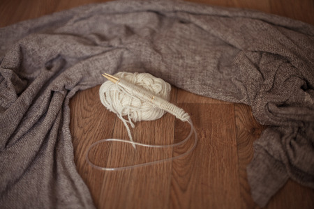 with loops: cozy knitting, a set of loops,brown background Stock Photo