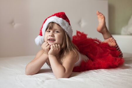 bottoms: Childrens feet in the New Years striped pajama bottoms to bed, home New Year