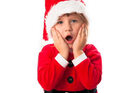 wow: wow surprised  funny child girl in Santa red hat and costume . Christmas concept.