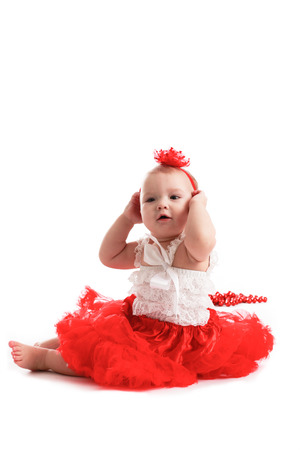 children love: girl in a red skirt and a bandage on a white background, the concept of Valentines Day Stock Photo