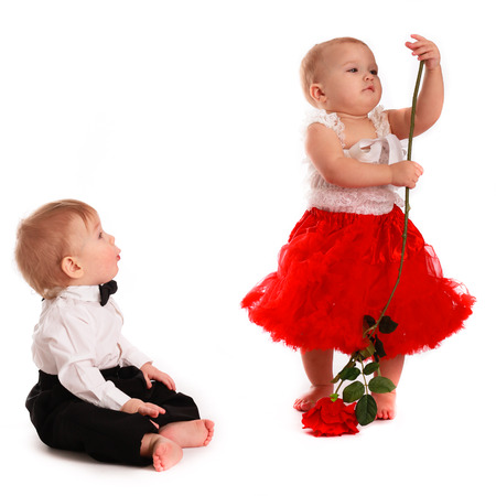 girl in a red skirt and boy and a gentleman, love, Boy admired and dancing girl with a flower rose, communication  white background, Valentines Day konept Imagens