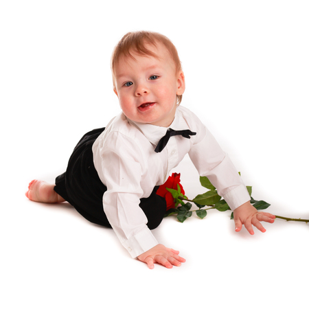 baby in suit: baby boy gentleman suit and tie butterfly on a white background with a rose, the concept of Valentines Day
