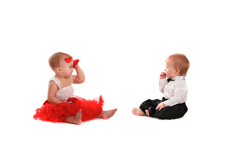 couple girl and boy kids babies playing with hearts concept valentine's day, communication, interaction, love,