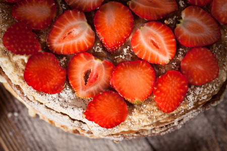 Cake of the pancakes, cake with strawberry top view of a dark brown wooden background, rustic style Stock Photo