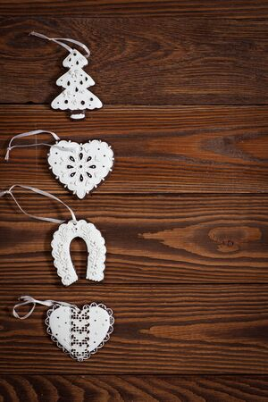 Christmas-tree cookies on a wooden background, concept of New Year and Christmas