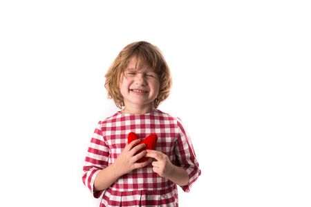 red plaid: funny Girl child in red plaid dress with red crocheting  heart,  Valentines Day concept, isolated on  white background, Stock Photo