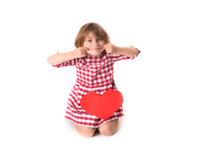red plaid: funny Girl child in red plaid dress with red paper  heart,  Valentines Day concept, isolated on  white background,