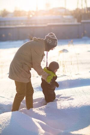 happy family, Dad and son plaing in snow  winter , the suns rays,