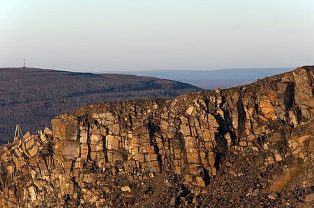 vertex: Landscape, place of extraction of rock recess in the cliff Stock Photo