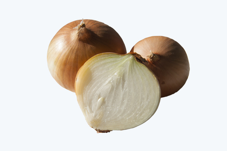 consumed: Close-up of three fruits golden onions, one sliced consumed. Izolyant. Stock Photo