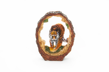 statuette: Statuette of a seated tiger close-up on a white background Stock Photo