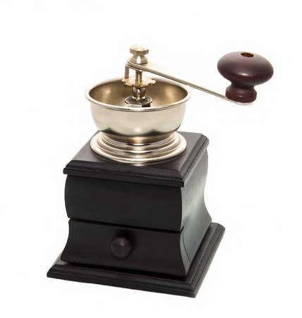 coffee grinder: Manual coffee grinder for grinding coffee beans on white background Stock Photo