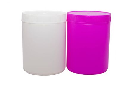 two plastic capacities of white and pink color, the identical size, stand nearby on a white background