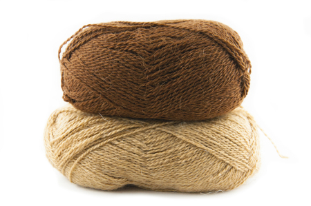 acryle: Two skeins for knitting of brown color, a light and dark shade of color, on a white background