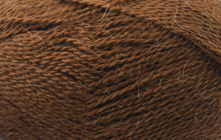 acryle: close up of a hank of brown yarn for knitting