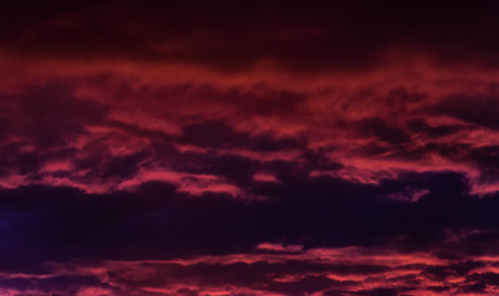 presentiment: the storm sky with various shades of red and violet color, with dark clouds
