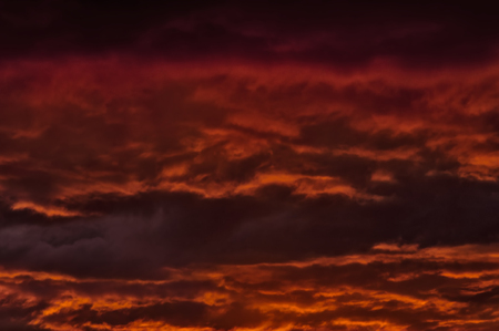 presentiment: the storm sky with various shades of red color, with dark clouds