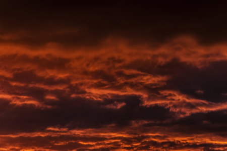 sky at sunset in the evening, darkly red color