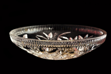 house ware: the plate from crystal lit with red light with a side on a black background Stock Photo