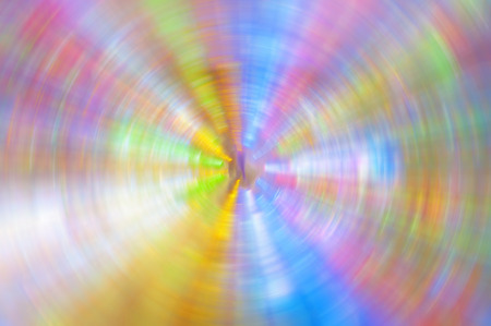 glowing lines of different colors diverge from the center to the edges in a circle, an abstraction, a blurred background