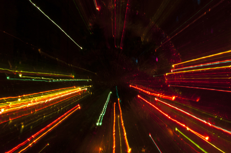 glowing lines of different colors diverge from the center to the edges, abstraction, background Reklamní fotografie