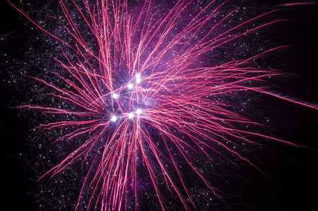 outbreak of fireworks of various colors against the black sky