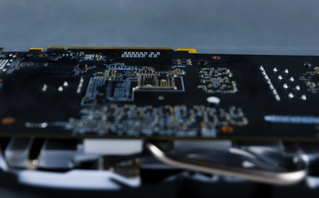 Close-up of the graphics card chip on the back side, computer equipment.