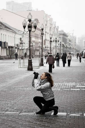 tourist girl taking photos on a street Stock Photo
