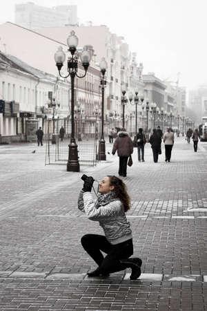 moscow city: tourist girl taking photos on a street Stock Photo