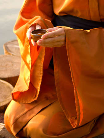 master of tea ceremony holding a cupo with tea in hands Stock Photo - 4616362