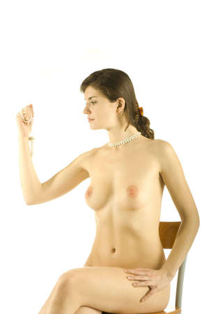 naked girl looking at beads in her hand isolated on white photo