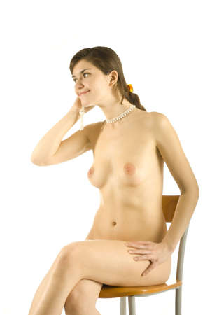 naked girl with beads in her hand isolated on white photo