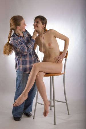 two girls, naked and dressed photo