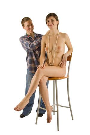 zwei Mädchen, nackt und bekleidet, isoliert auf weißem Lizenzfreie Bilder - 4786550