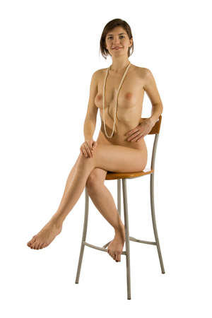 smiling naked girl with pearl beads sitting on a chair isolated on white Stock Photo
