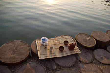 tea ceremony set on a straw mat on the lake bank Stock Photo - 6460126