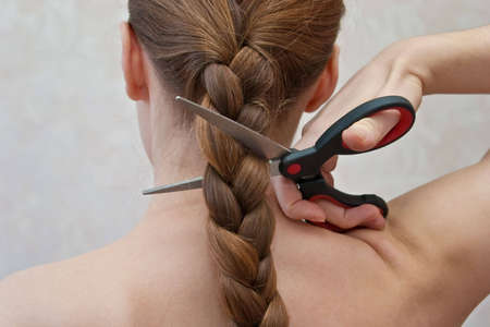 close-up of cutting off a braid photo