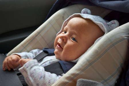 love seat: happy little boy in car seat Stock Photo