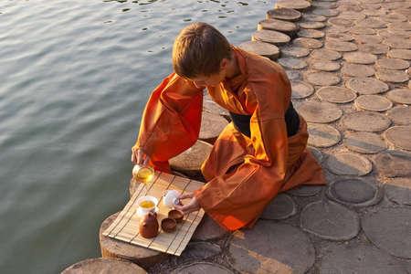 tea ceremony master serving tea near the water Stock Photo - 7118366