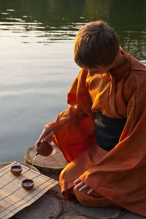 tea ceremony master serving tea near the water Stock Photo - 7118361