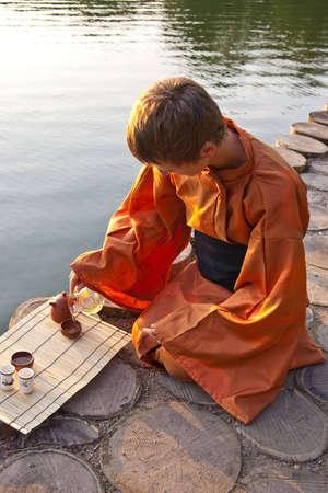 tea ceremony master serving tea near the water Stock Photo - 7118364