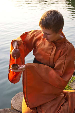 tea ceremony master serving tea near the water photo