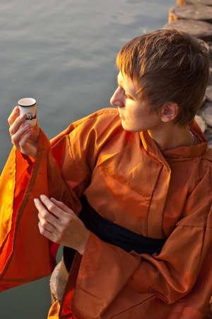 tea ceremony master serving tea near the water Stock Photo - 7118362