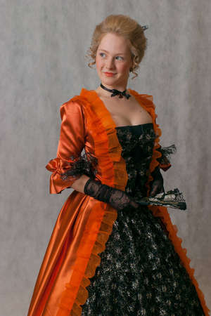 studio shot of standing girl with baroque dress and hairstyle photo