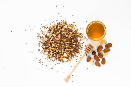 Granola multigrain with honey and nuts isolated on white background. Healthy food. Flat lay, top view