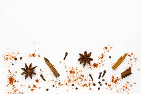 Set of spices. Cinnamon, clove and star anise on white background with copy space, top view, flat lay.