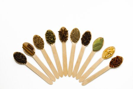 composition of set spices in wooden spoons on a white background. top view. flat lay. with copy space. fan Standard-Bild